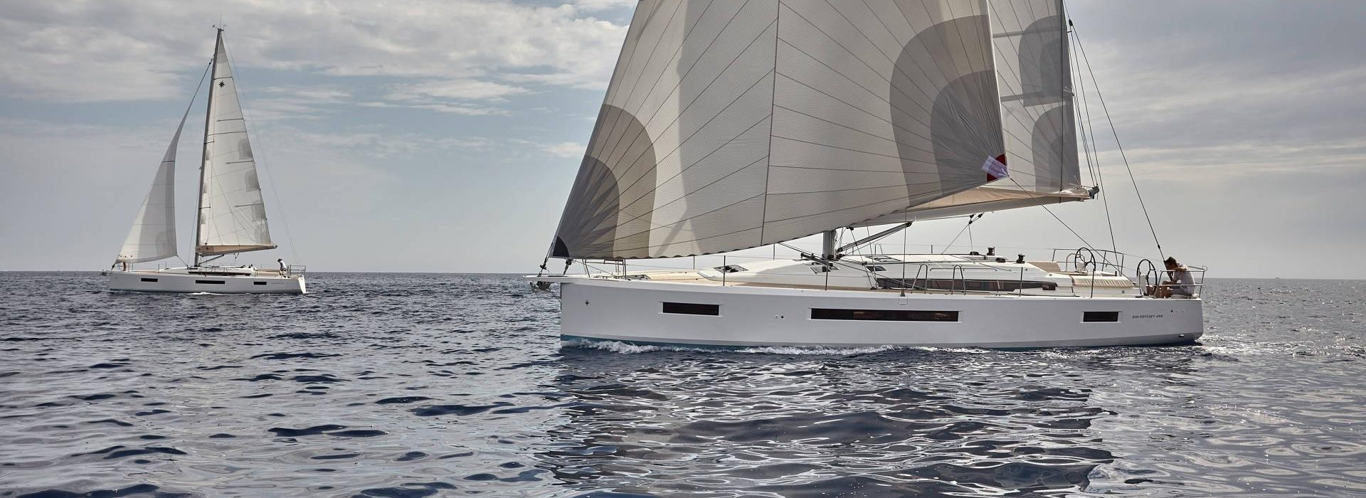 2 Jeanneau Sun Odyssey 490s sailing in open water