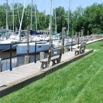 view of marina slips and waterside benches