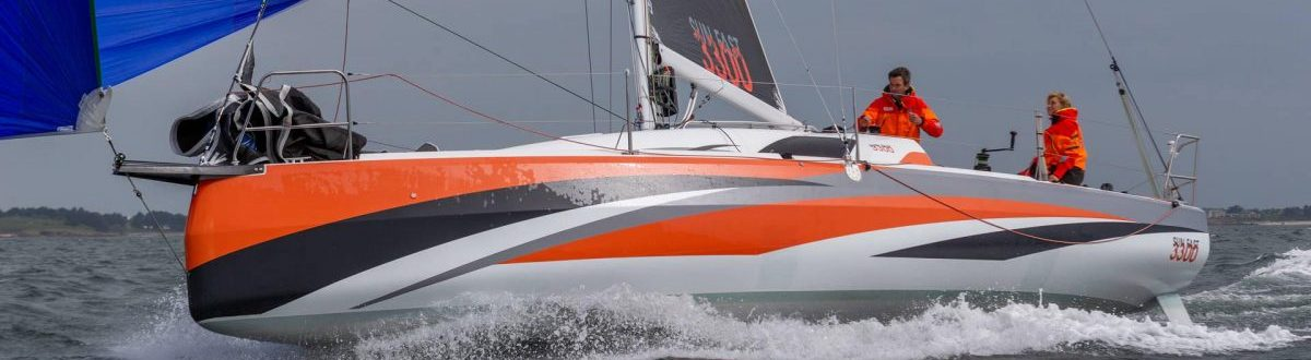 sunfast 3300 sailing in cloudy weather
